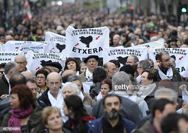 People hold banners demanding the repatriation of Basque prisoners during a demonstration called by several Basque political parties trade unions and...