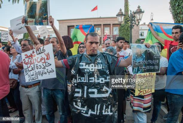 People hold banners during a demonstration over the death of Imad El Attabi who was hit in the head during the clashes that broke off on the 20th of...