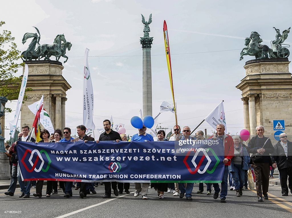 People hold banners during a May Day International Worker's Day rally in Budapest Hungary on May 01 2015 Labour Day was commemorated on May 01...
