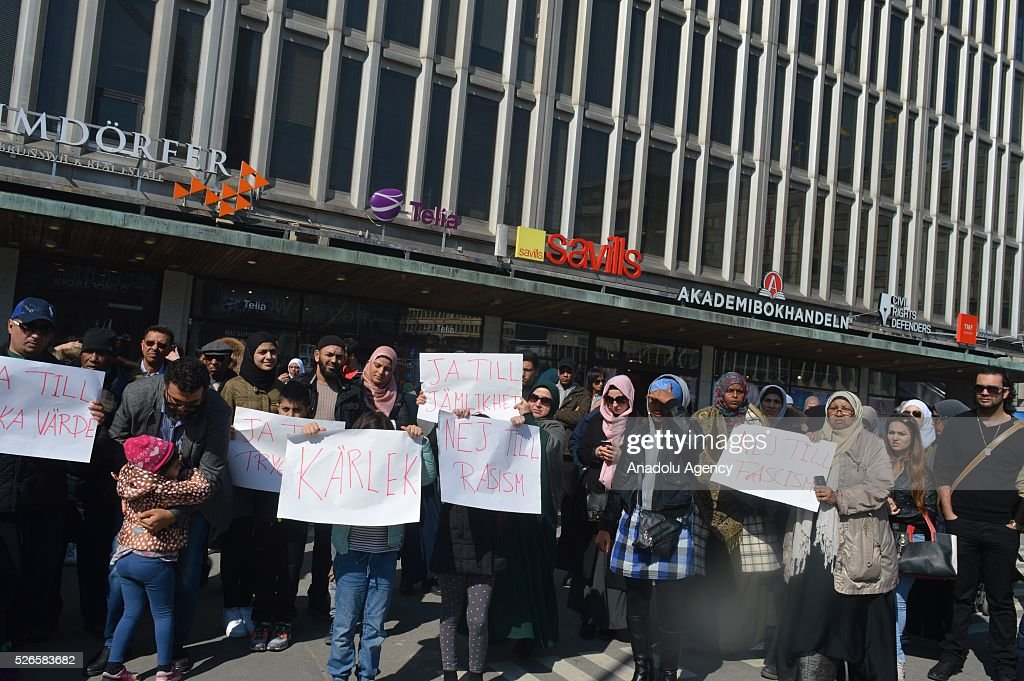 People hold banners during a protest against Islamophobic broadcast, at Segel Torg Neighborhood, in Stockholm, Sweden on April 30, 2016.