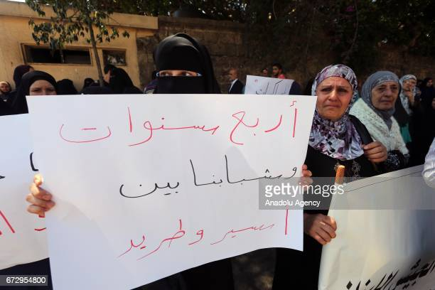 People hold banners during a protest against postponement of Ahmad AlAssir's trial in Beirut Lebanon on April 25 2017 Protesters including relatives...