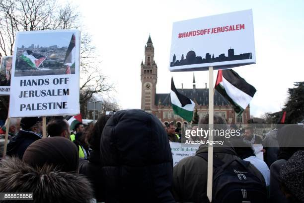 People hold banners during a protest against US President Donald Trump's announcement to recognize Jerusalem as the capital of Israel and plans to...