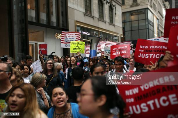 People hold banners during a rally against US President Donald J Trump's potential repealing of Deferred Action for Childhood Arrivals which protects...