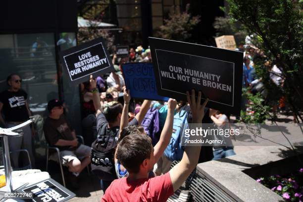 People hold banners reading 'Love Restores Our Humanity' and ' Our Humanity Will Not Be Broken' during a rally held by Council on AmericanIslamic...