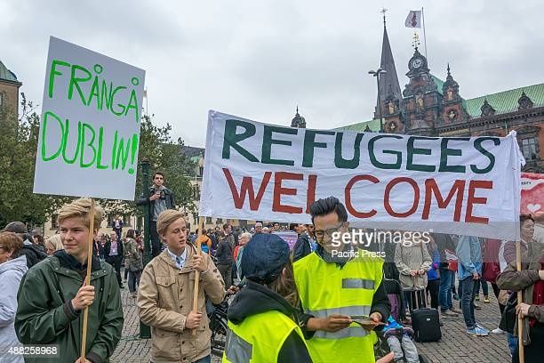 People hold banners welcoming refugeesThere are 5000 estimated people who joined in a rally in Sweden putting pressure on both the national and...