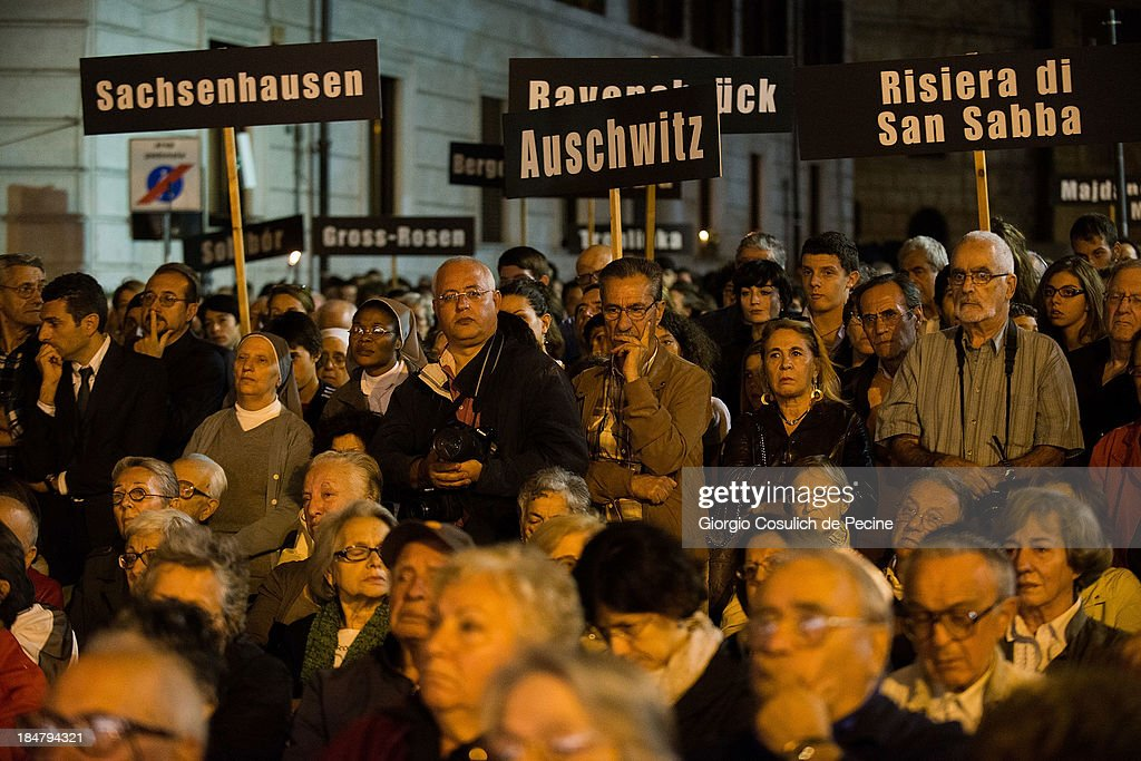 People hold banners with concentration camps names as they attend the commemoration of the 70th anniversary of the deportation of Roman Jews on October 16, 2013 in Rome, Italy. On October 16, 1943, Nazi troops invaded the streets of Portico d'Ottavia, in the Jewish ghettos of Rome, and took 1,024 people, including more than 200 children, who were later destined for the concentration camps of Auschwitz. Only fifteen men and one woman returned home from Poland.