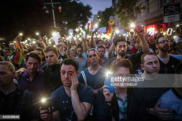 TOPSHOT People hold candels and lights during a vigil in solidarity outside Manhattan's historic Stonewall Inn to express their support for the...