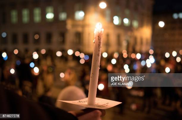 TOPSHOT People hold candles during a rally under the slogan 'Our ministries not in the hands of rightwing extemists' on 15 November 2017 outside the...