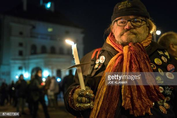 People hold candles during a rally under the slogan 'Our ministries not in the hands of rightwing extemists' on 15 November 2017 outside the...