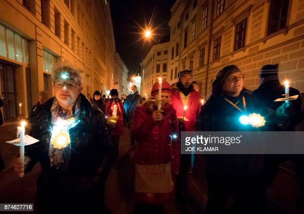 People hold candles during a rally under the slogan 'Our ministries not in the hands of rightwing extemists' on 15 November 2017 near the Austrian...