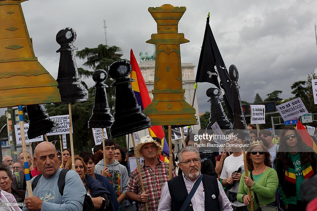 People hold cardboard chess figures cutouts during a demonstration against the Spanish Monarchy under the header 'Check the King' at Princesa Street on September 28, 2013 in Madrid, Spain. Organizers call for a demonstration on the anniversary of 'Surround the congress protest' to claim the abolition of the Monarchy. Currently King Juan Carlos of Spain is in hospital recovering from a hip operation. The Spanish Royal Family has lost popularity since the King injured his hip on elephant hunting trip and the King's son-in-law, Inaki Urdangarin is being investigated over a corruption scandal.