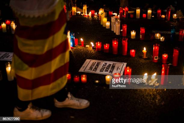 People hold cnadles during candlelit demonstration and protests against the arrest of President of the Omnium Cultural Jordi Cuixart and president of...