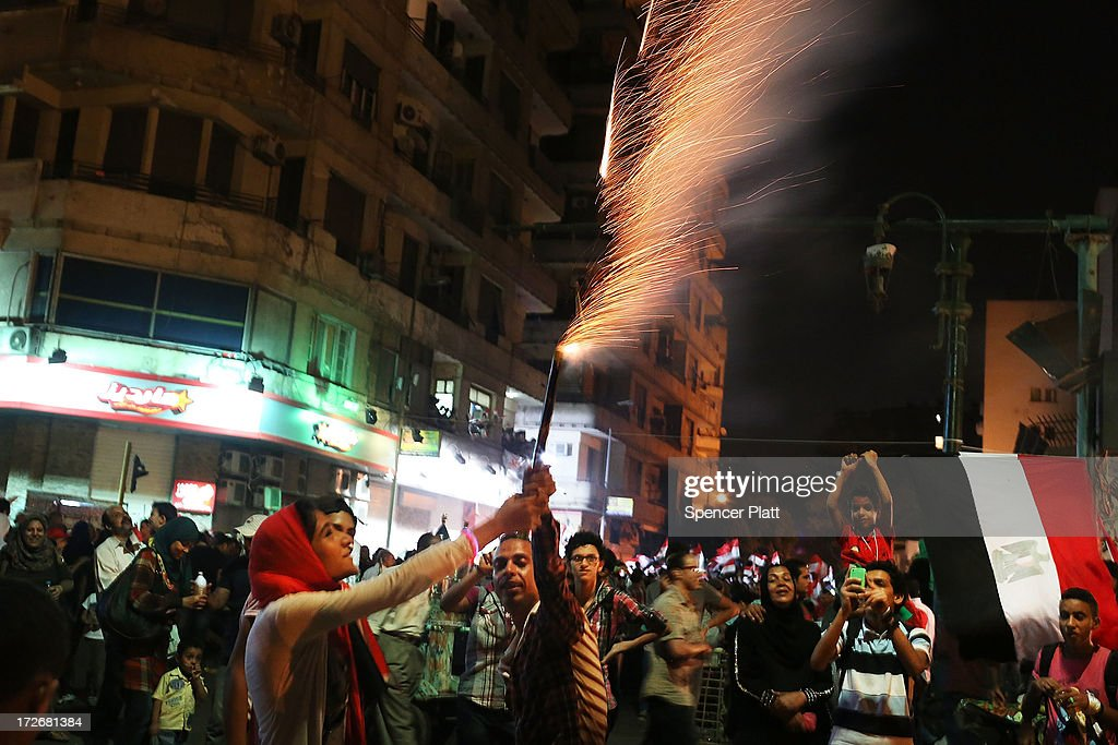 People hold fireworks in Tahrir Square, the day after former Egyptian President Mohammed Morsi, the country's first democratically elected president, was ousted from power on July 4, 2013 in Cairo, Egypt. Adly Mansour, chief justice of the Supreme Constitutional Court, was sworn in as the interim head of state in ceremony in Cairo in the morning of July 4, the day after Morsi was placed under house arrest by the Egyptian military and the Constitution was suspended.