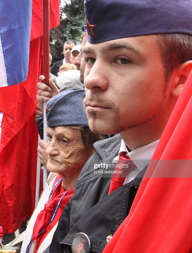 People hold flags and wear communist-era hats as they comemorate ex-Yugoslav communist leader Josip Broz Tito's birthday in Sarajevo, on May 25, 2013. As the last Yugoslav king Petar II Karadjordjevic was reburied in Serbia on May 26, hundreds of supporters of his post-World War II political rival, communist leader Josip Broz Tito, marked the 121st anniversary of his birthday throughout his former homeland. Josip Broz was born on May 25, 1892 in Croatia. He later became Yugoslav communist party leader and a lifetime president of Yugoslavia. He died on May 4, 1980 and after his death Yugoslavia fell apart and the socialist ideas mostly vanished in the region torn apart by nationalist policies led by his successors in all ex-Yugoslav republics.