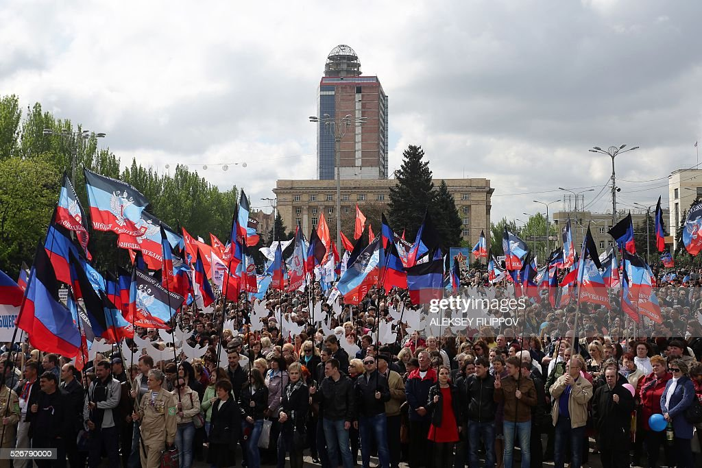 People hold flags of the self-proclaimed People's Republic of Donetsk during a May Day rally in the centre of the eastern Ukrainian city of Donetsk on May 1, 2016. / AFP / Aleksey Filippov