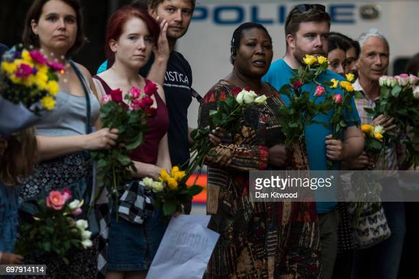People hold flowers as they attend a vigil outside Finsbury Park Mosque on June 19 2017 in London England Worshippers were struck by a hired van as...