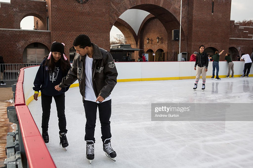 People hold hands while ice skating at the ice rink at McCarren Pool, which opened for the winter months last week, on November 22, 2013 in the Green Point neighborhood of the Brooklyn borough of New York City. McCarren Pool originally opened in 1936, though it closed in 1984; it reopened in 2012 after a multimillion dollar remodeling. The winter ice rink was unable to open last winter due to complications; this year it is scheduled to stay open through January 5th, 2014.