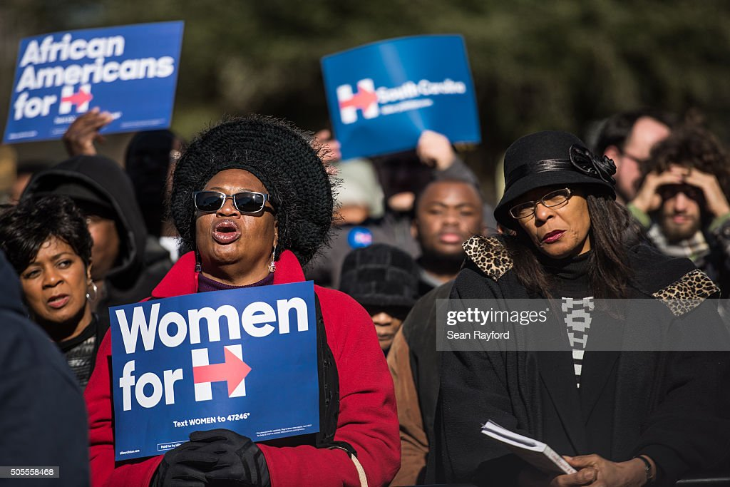 People hold Hillary Clinton campaign signs during the King Day at the Dome rally at the SC State House at the SC State House January 18 2016 in...