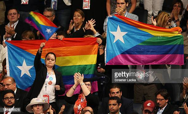 People hold LGBT flags during the final day of the Democratic National Convention at Time Warner Cable Arena on September 6 2012 in Charlotte North...
