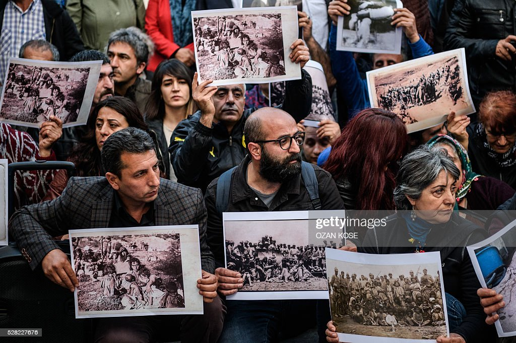 People hold pictures depicting killed victims of Dersim massacre between 1936 and 1939, during a demonstration on May 4, 2016 in Istanbul. Air strikes and ground operations in the city of Dersim (now named Tunceli) killed 13,800 people between 1936 and 1939, according to an official document Erdogan said in 2011 / AFP / OZAN
