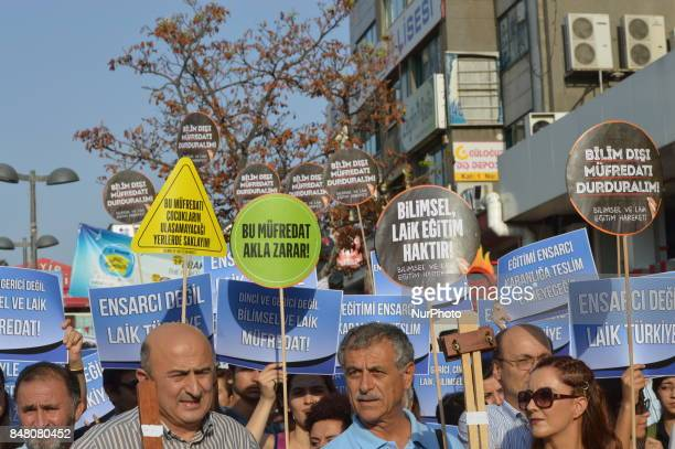 People hold placards as they protest against the Turkish government's new education policies in Ankara Turkey on September 16 2017 The Turkish...