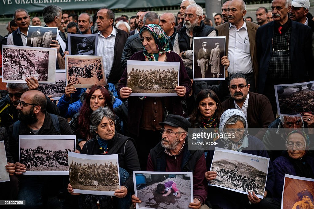 People hold placards depicting killed victims of Dersim massacre between 1936 and 1939, during a demonstration on May 4, 2016 in Istanbul. Air strikes and ground operations in the city of Dersim (now named Tunceli) killed 13,800 people between 1936 and 1939, according to an official document Erdogan said in 2011 / AFP / OZAN