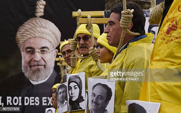 TOPSHOT People hold placards displaying portaits as they take part in a demonstration denouncing Iran's use of the death penalty on January 28 2016...