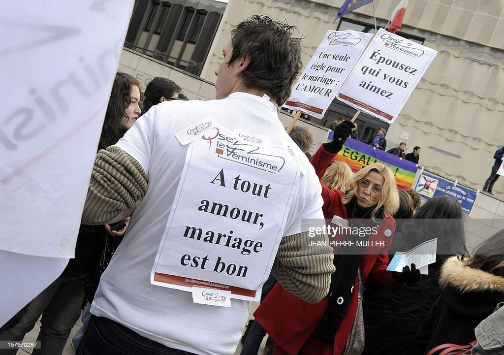 People hold placards during a demonstration to support same sex marriages in Bordeaux, south eastern France on December 8, 2012.
