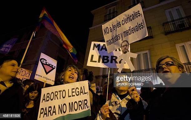 People hold placards meaning 'Legal abortion to stop death' and 'No to clerical macho and medieval laws' during a prochoice demonstration in Madrid...