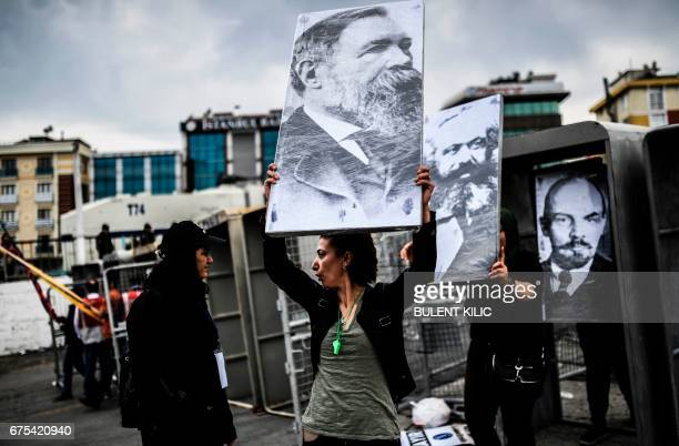 People hold placards picturing German philosopher and communist thinker Friedrich Engels German philosopher and communist theoretician Karl Marx and...