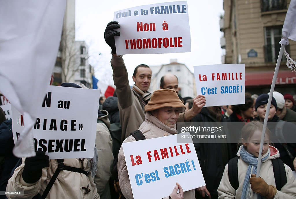 People hold placards reading 'Family is sacred!' during a protest organized by fundamentalist Christians group Civitas Institute against same-sex marriage on January 13, 2013 in Paris. Tens of thousands march in Paris on January 13 to denounce government plans to legalise same-sex marriage and adoption which have angered many Catholics and Muslims, France's two main faiths, as well as the right-wing opposition. The French parliament is to debate the bill -- one of the key electoral pledges of Socialist President -- at the end of this month.