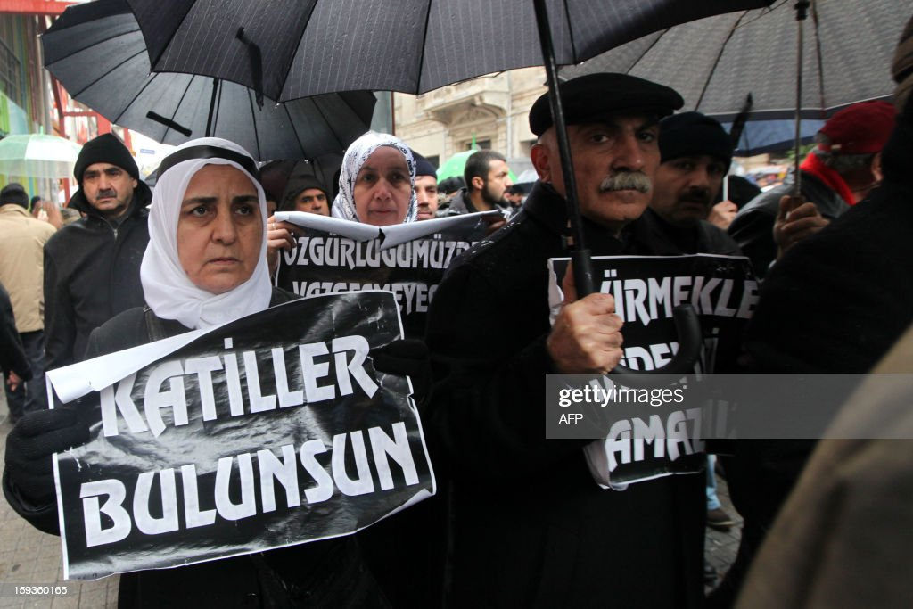 People hold placards reading 'Find tje killers' during a rally in front of the French Consulate in Istanbul on January 11, 2013. Demonstrators gathered at the French Consulate in Istanbul following the killings of three Kurdish women activists on 10 January, including Sakine Cansiz, a founding member of the militant Kurdistan Workers Party (PKK). Cansiz, who had been living in exile in France for years, was found dead in the early hours of 10 January in a Kurdish documentation centre on the first floor of an apartment building near Gare du Nord train station. Two other women - the president of the centre, Fidan Dogan, and Leyla Soylemez, also described as an activist - were also killed.