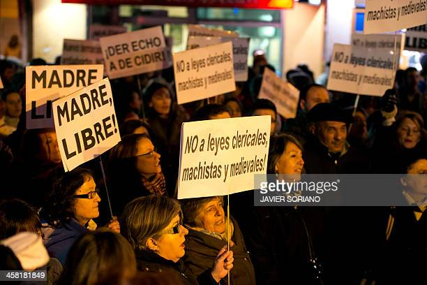 People hold placards reading 'Mother free' and 'No to clerical macho and medieval laws' during a prochoice demonstration in Madrid against the...