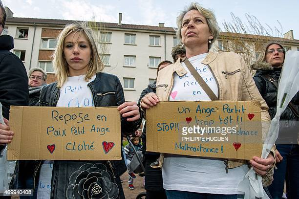 People hold placards reading 'Rest in peace little angel Chloe' and 'An angel gone too early Stop to pedophilia violence or abuse' as the take part...