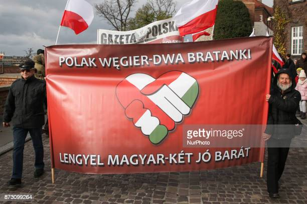 People hold ' Pole and Hungarian two good friends ' banner during the official celebration of the Polish Independence Day in Krakow Poland on 11...