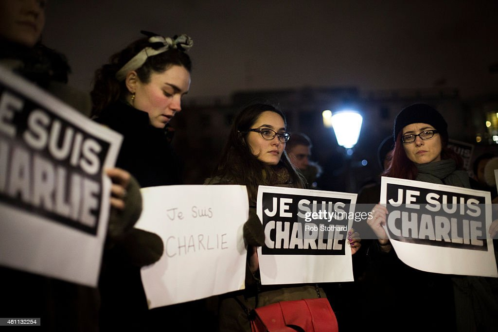People hold posters reading 'Je suis Charlie' during a vigil in Trafalgar Square for victims of the terrorist attack in Paris on January 7 2015 in...