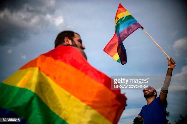 TOPSHOT People hold rainbow flags as they take part in the annual Gay Pride Parade in central Sofia on June 10 2017 / AFP PHOTO / NIKOLAY DOYCHINOV