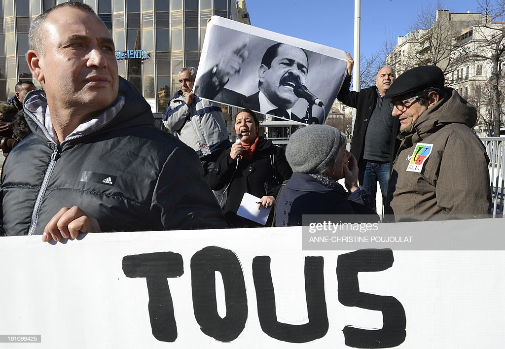 People hold signs bearing pictures of murdered opposition figure Chokri Belaid and reading 'All' during a protest to pay tribute to Belaid on February 9, 2013, in Marseille, southern France. The shooting of Belaid, a leftist leader and outspoken government critic by a lone, hooded gunman on February 6, 2013 plunged Tunisia into new post-revolt turmoil as tension and division within the Ennahda party itself intensified.