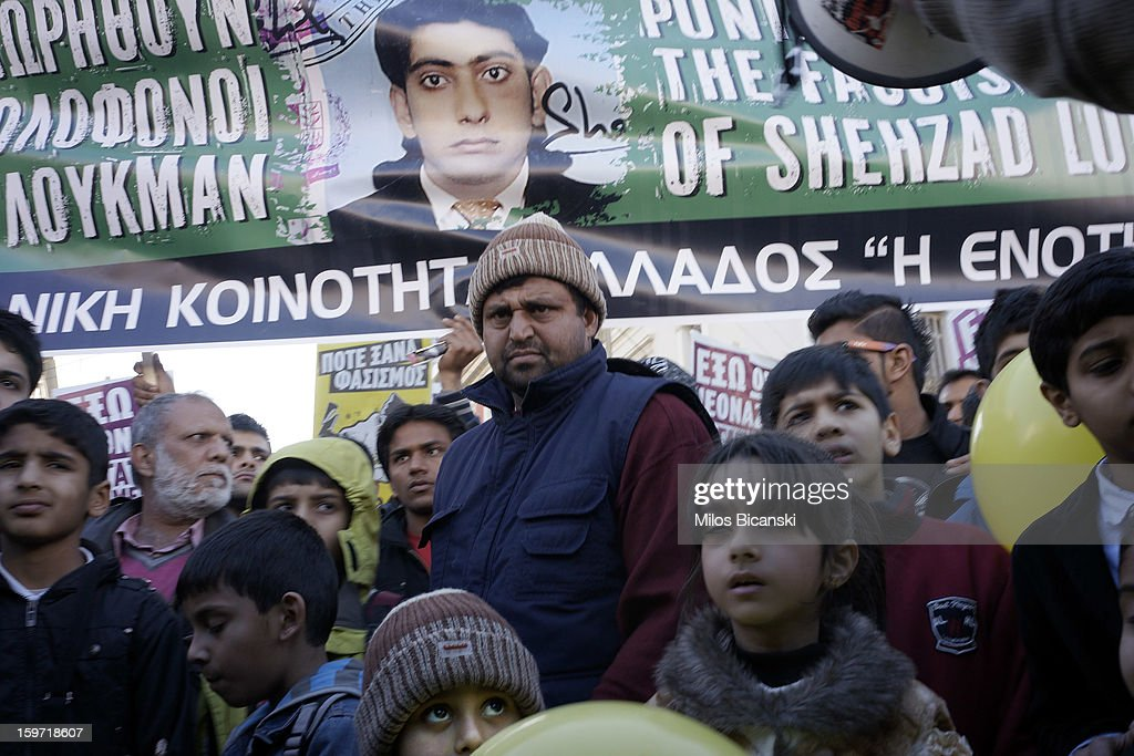 People hold signs during a demonstration in response to the killing of 27-year-old Pakistani migrant who was a victim of an alleged racism-fuelled crime on January 19, 2013 in Athens, Greece. Hundreds of Greeks and other nationals marched peacefully against racism on January 19. Long standing as a hub for immigration from the Middle East, Africa and Asia, Greece is under pressure with racial issues as the economic crisis warps the burdens of blame in struggling communities.