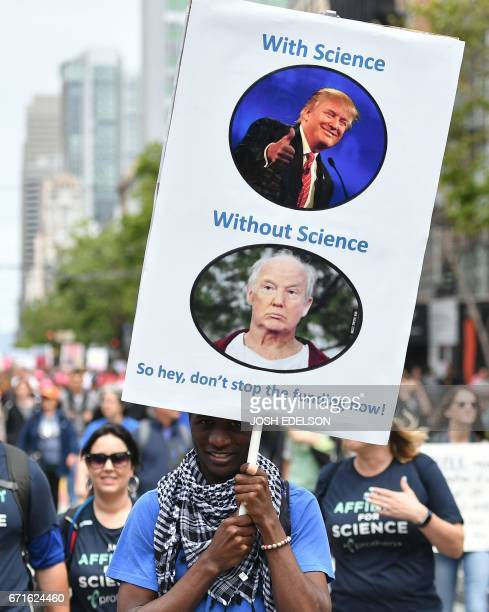 People hold signs during the March for Science in San Francisco California on April 22 2017 Thousands of people joined a global March for Science to...