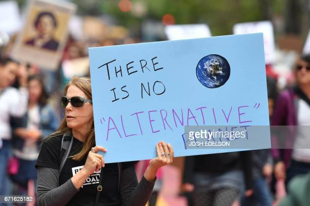 People hold signs during the March for Science in San Francisco California on April 22 2017 Day Thousands of people joined a global March for Science...