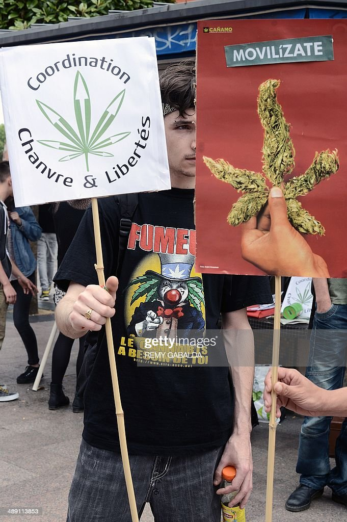 People hold signs reading ''Coordination hemp and freedoms'' during a protest to call for the legalization of marijuana on May 10, 2014 in Toulouse, southern France. About 147 million people globally -- or about 2.5 percent of the population -- use cannabis, according to the World Health Organization. GABALDA