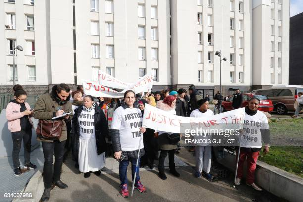 People hold signs reading 'Justice for Theo' during a protest on February 6 2017 in AulnaysousBois northern Paris a day after a French police officer...