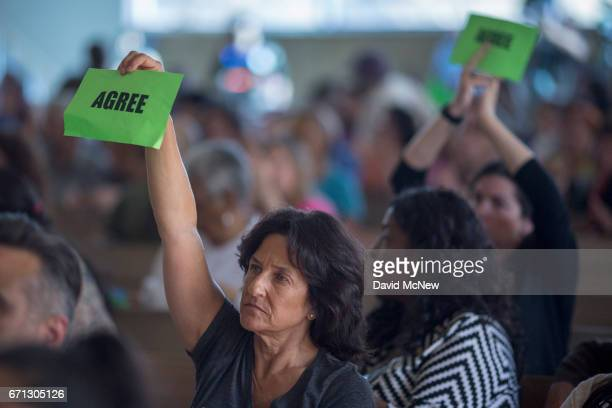 People hold signs to express agreement as US Senator Kamala D Harris holds a town hall at Holman United Methodist Church on April 21 2017 in Los...