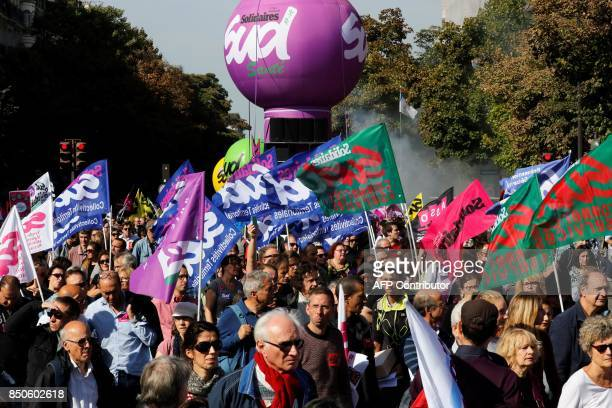 People hold SUD French worker's union flags as they march during a rally to protest the French government's proposed reforms in labour laws on...