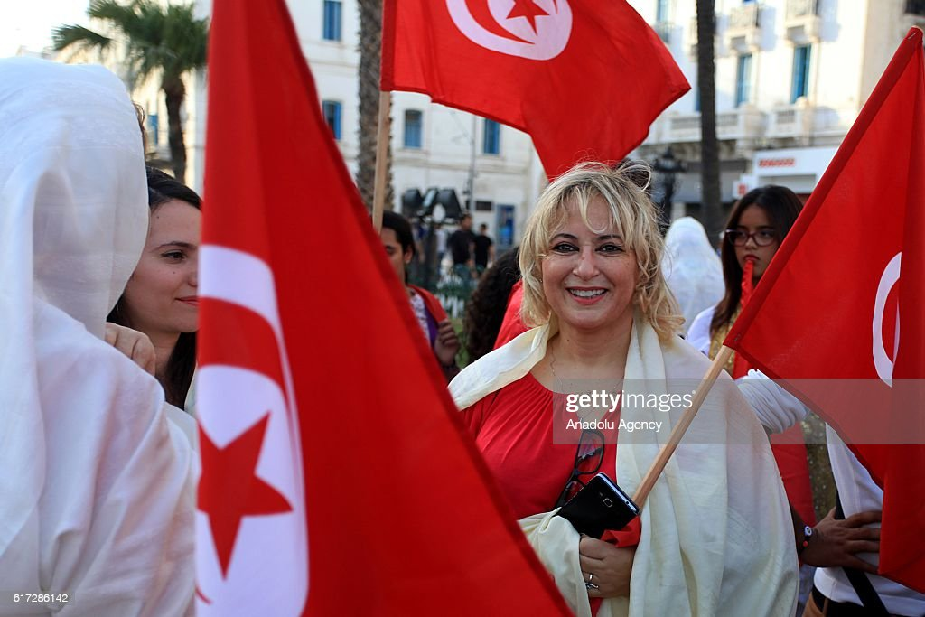 People hold Tunisian flags at the Habib Bourguiba street during the 189th anniversary of Tunisian flag in Tunis, Tunisia on October 22, 2016.