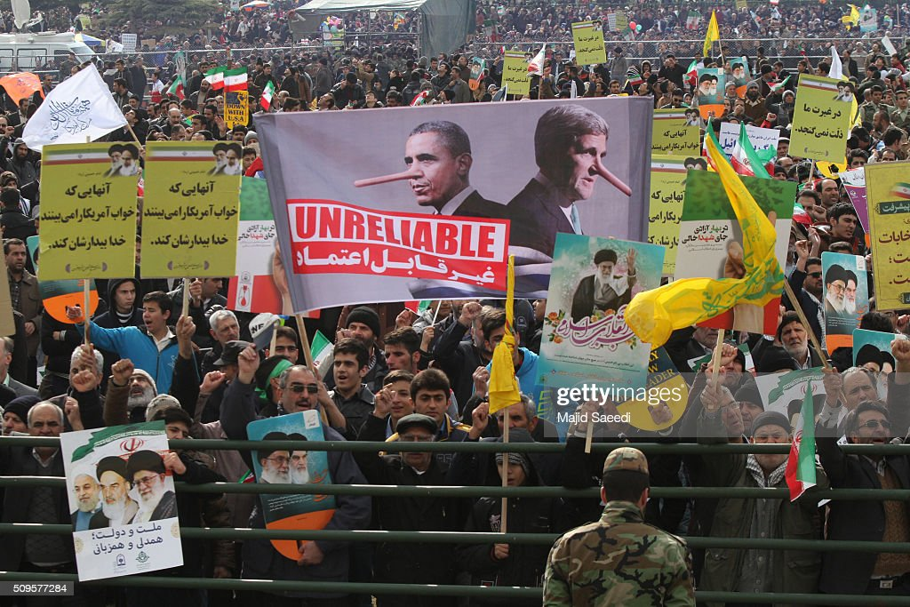People hold up an anti-U.S. banner at a rally to mark the 37th anniversary of the Islamic revolution in Azadi Square (Freedom Square) on February 11, 2016 in Tehran, Iran. Rallies and celebrations are being held across the country. President Hassan Rouhani has urged the public to turn out for the upcoming parliamentary and Constitutional Council elections.