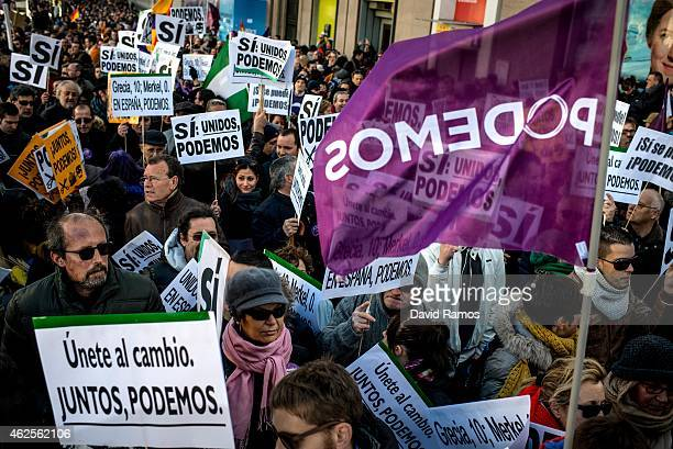 People hold up banners during a march of Podemos political party on January 31 2015 in Madrid Spain According to the last opinion polls Podemos the...