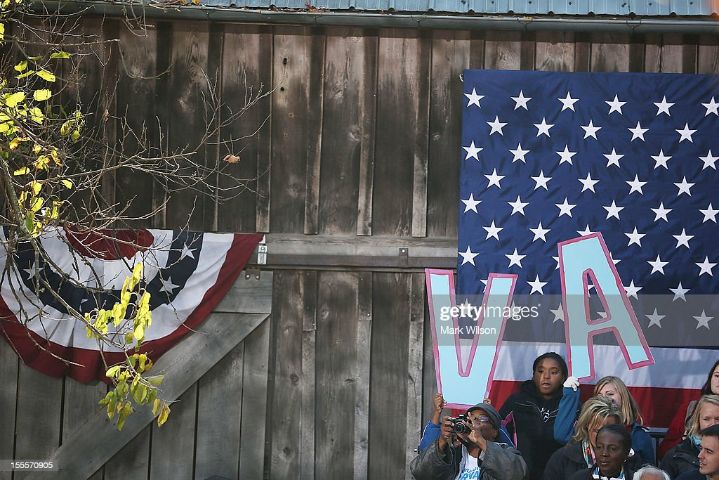 People hold up letters during a campaign rally for U.S. Vice President Joe Biden at the Heritage Farm Museum, on November 5, 2012 in Sterling, Virginia. Tomorrow voters nationwide will head to the polls to vote in the presidential and congressional elections.