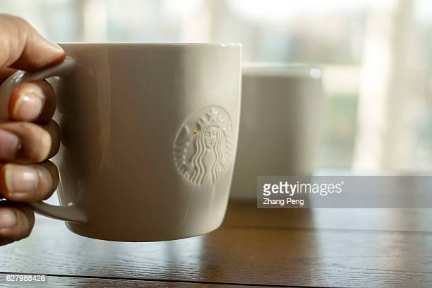 People holding a Starbucks coffee cup At the end of November a Chinese customer posted an open letter online to the chief executive of Starbucks in...